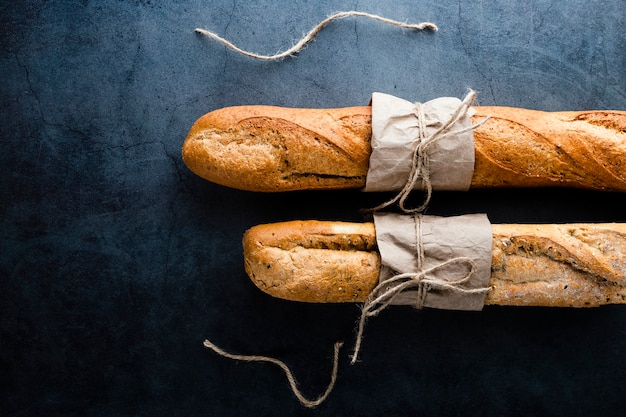 Top view of baguettes on black background Premium Photo