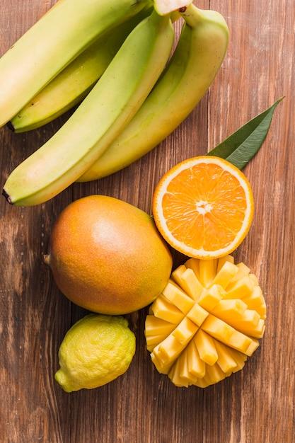 Top view bananas, orange and mango Free Photo