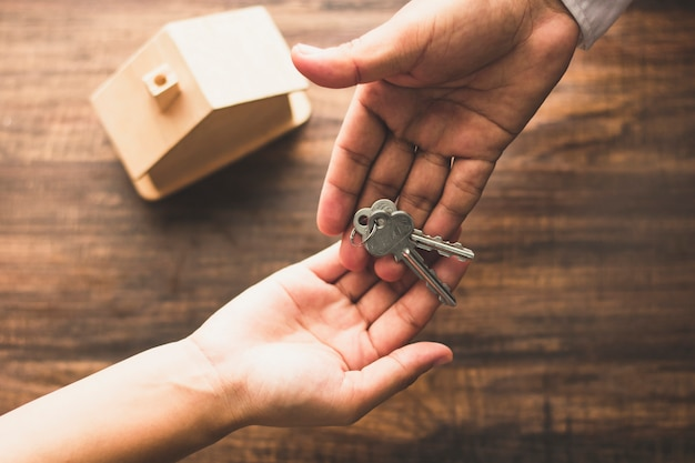 Top view of banker agency give house key to buyer Premium Photo