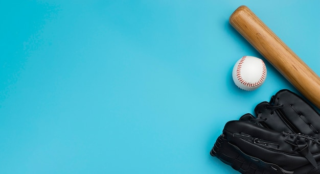 Top view of baseball bat with ball and gloves Free Photo