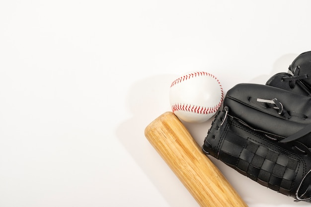 Top view of baseball bat with glove and ball Free Photo