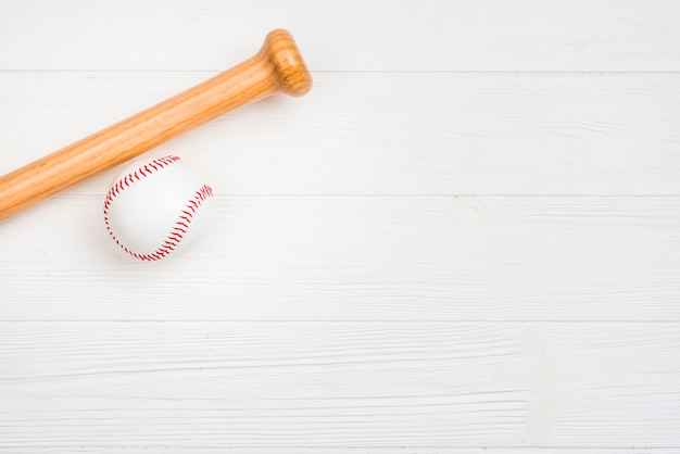 Top view of baseball and wooden bat Free Photo