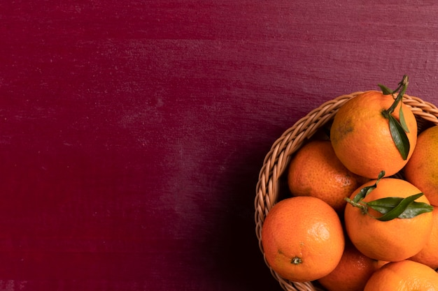 Top view of basket of tangerines for chinese new year Free Photo