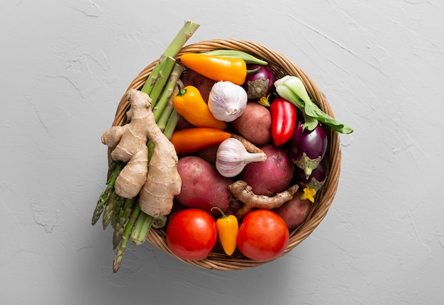 Top view basket with assortment of vegetables Free Photo
