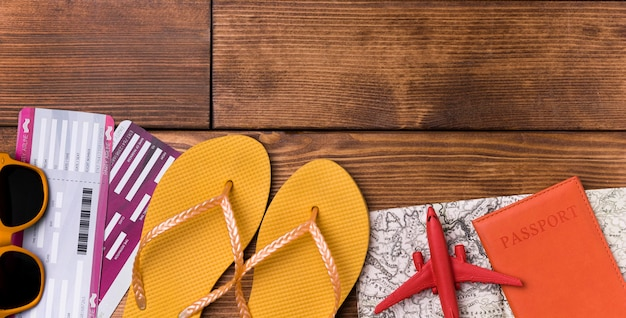 Top view beach slippers with passport on the table Free Photo