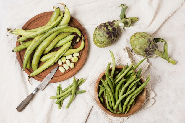 Top view of beans and artichokes Free Photo