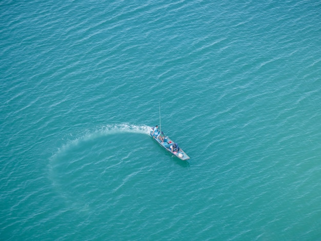 Top view of beautiful fishing boats on the sea and clear water. Premium Photo