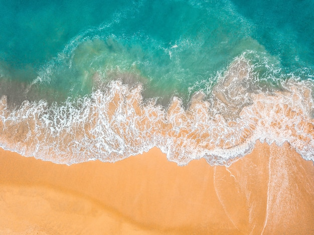 Top view of beautiful sand beach with turquoise sea water Premium Photo