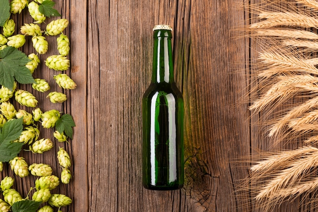 Top view beer bottle with ingredients Free Photo