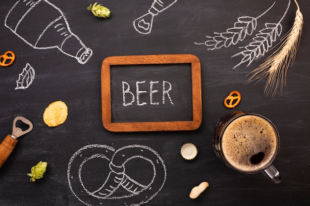 Top view beer with chalkboard background Free Photo