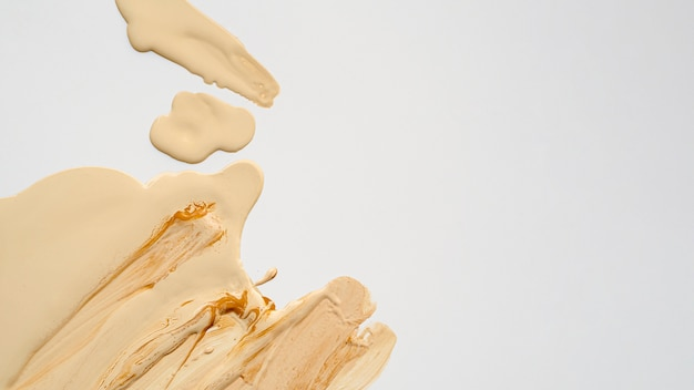 Top view beige foundation with copy space Free Photo