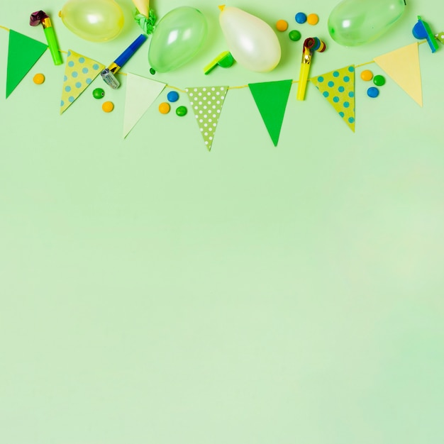 Top view birthday decoration on green background with copy space Free Photo
