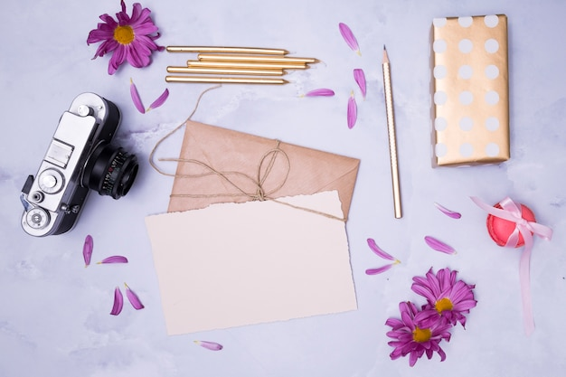 Top view birthday gifts on marble background Free Photo