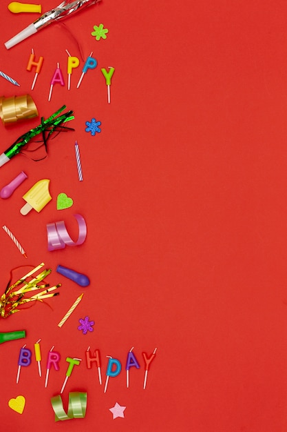 Top view birthday ornaments on red background Free Photo
