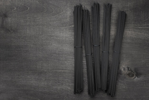 Top view of black spaghetti bundles with copy space Free Photo