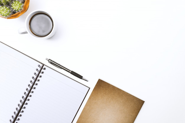 Top view blank notebook, pen and glasses on white desk Premium Photo