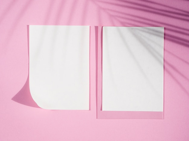 Top view blank papers with shadows Free Photo