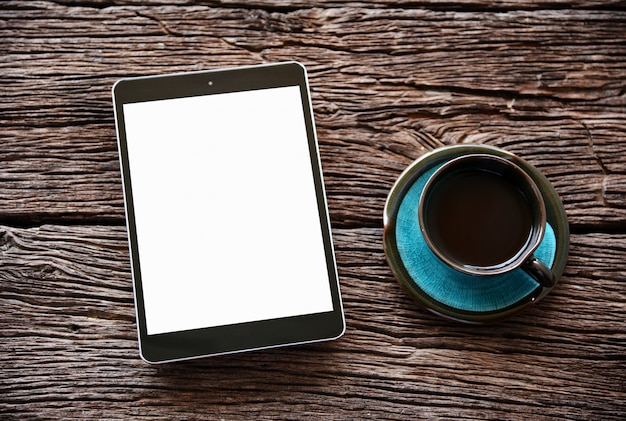 Top view blank screen tablet and coffee on wooden table.with copy space. Premium Photo