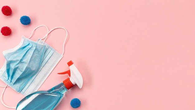 Top view blue medical masks and disinfectant with copy-space Premium Photo