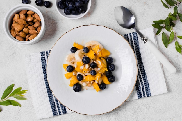 Top view of blueberries and mango on plate Free Photo