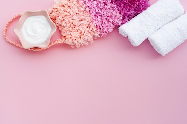 Top view of body butter on pink background with copy space Free Photo