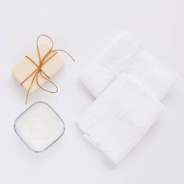 Top view of body butter and soap on plain background Free Photo