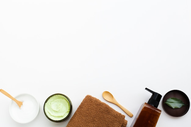 Top view of body butter on white background with copy space Free Photo