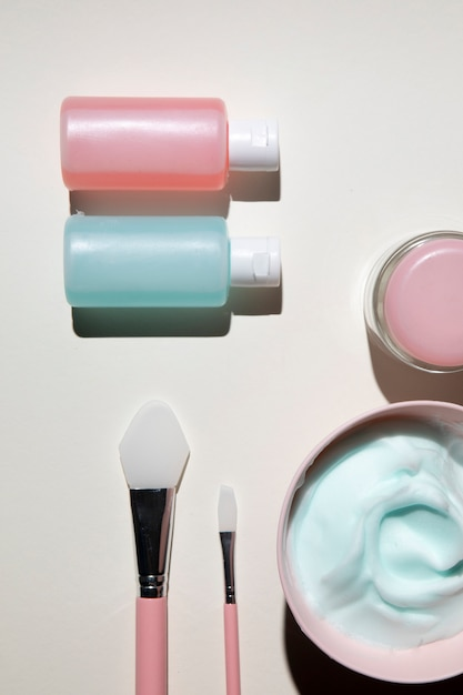 Top view of body cosmetics with plain background Free Photo