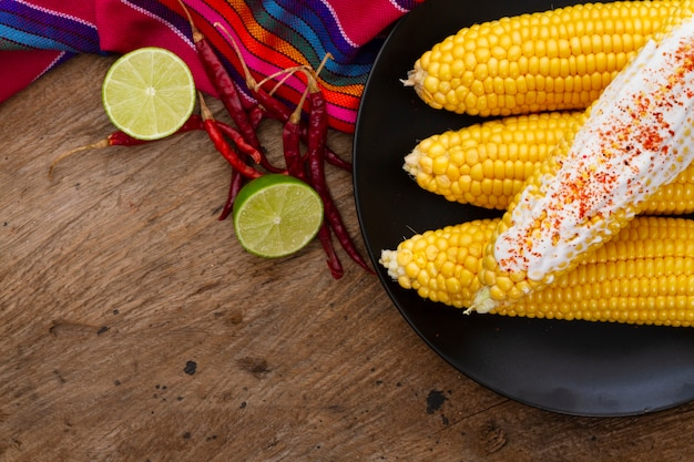 Top view boiled corn with chili powder Free Photo