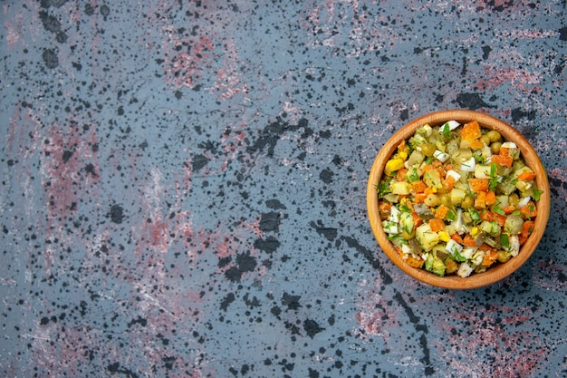 Top view of boiled vegetable salad inside plate, copy space Free Photo
