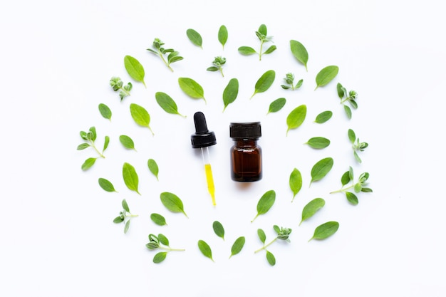 Top view. bottle of essential oil with marjoram on white Premium Photo