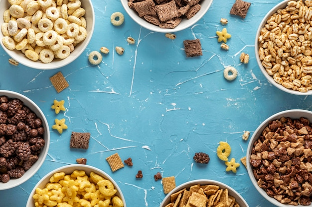 Top view of bowls with selection of breakfast cereals Free Photo