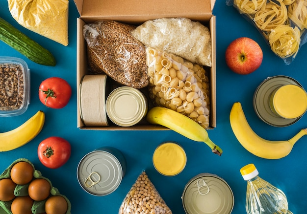 Top view of box with food for donation Free Photo