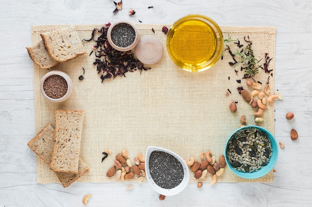 Top view of bread and healthy ingredients arranged on placemat Free Photo