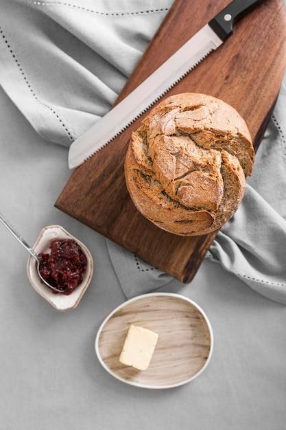 Вид сверху хлеб с джемом и маслом Бесплатные Фотографии