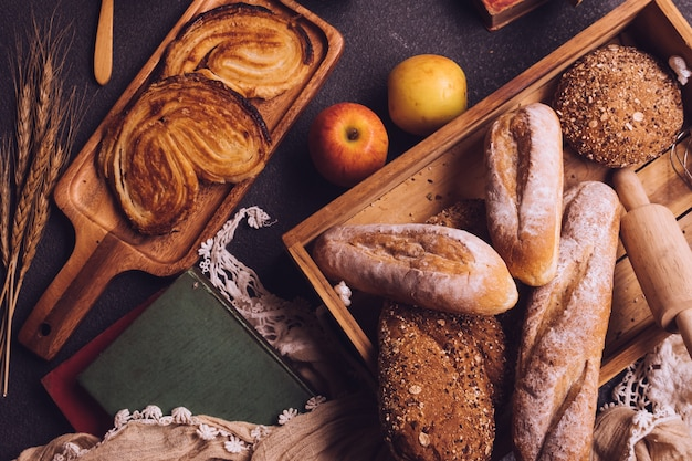 Top view of breakfast scene with freshly baked bread and fruits on the table Premium Photo