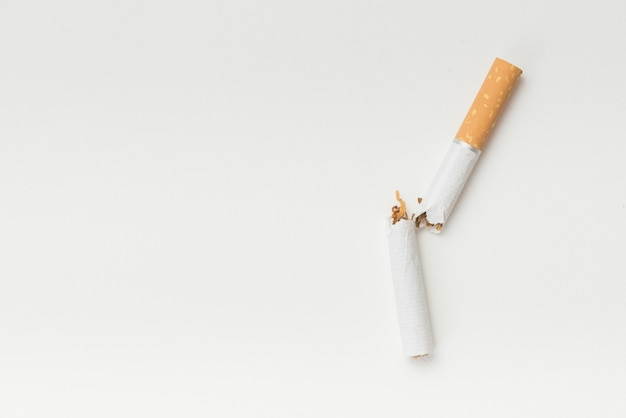 Top view of broken cigarette on white background Free Photo