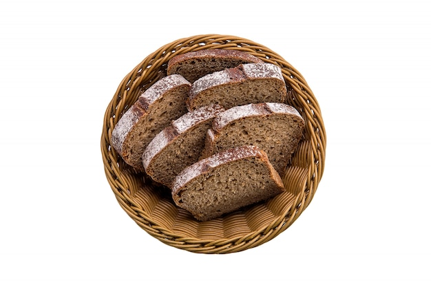 Top view of brown bread in basket isolated on white Premium Photo