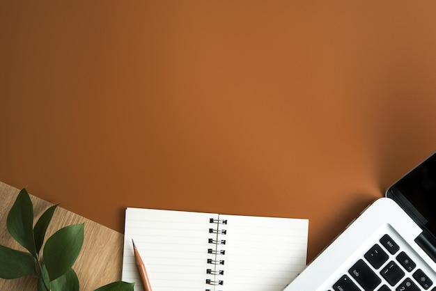 Top view of brown office desk table with copy space. flat lay. Premium Photo