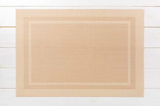 Top view of brown place mat for a dish. wooden background with empty space for your design Premium Photo