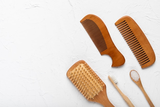 Top view brush and combs on table Free Photo
