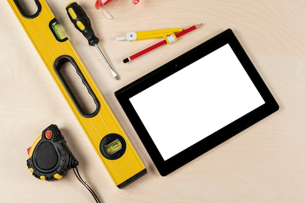 Top view of builder desk with tablet mock-up Free Photo