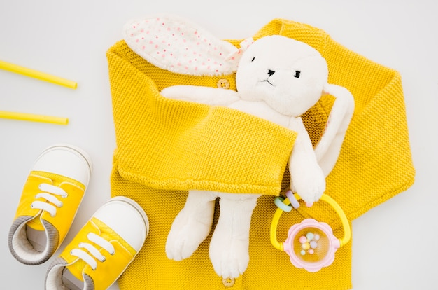 Top view bunny toy with yellow sweater Free Photo
