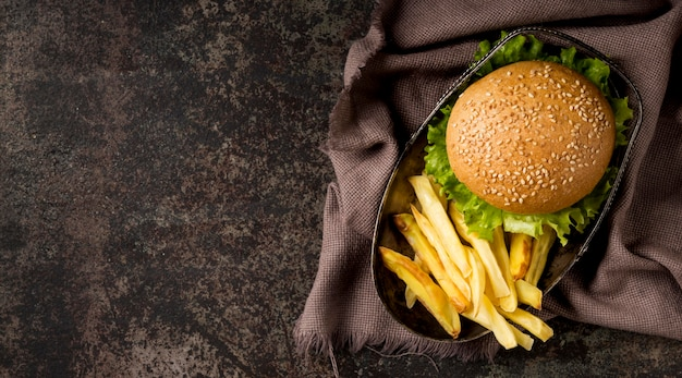 Top view burger and fries with kitchen towel Free Photo