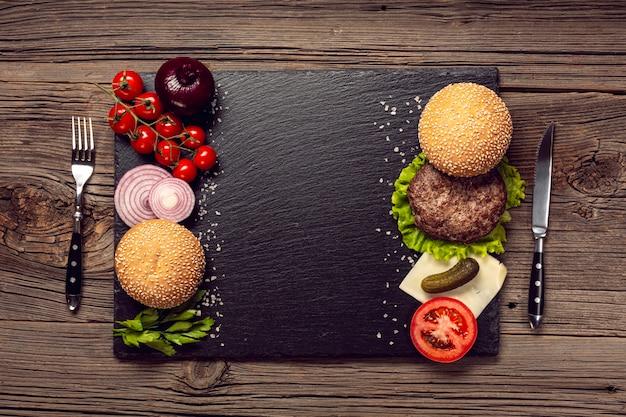 Top view burger ingredients on slate board Free Photo