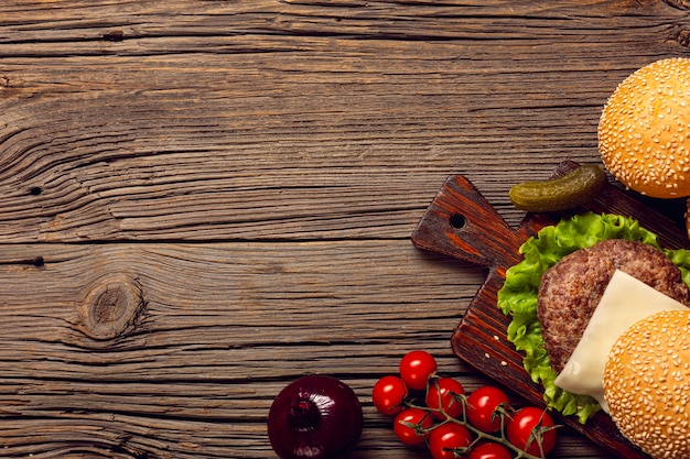 Top view burger ingredients on wooden table Free Photo