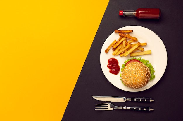 Top view burger with french fries with copy space Free Photo