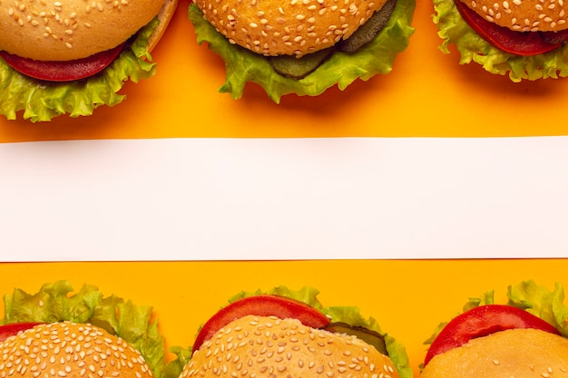 Top view burgers with a white stripe Free Photo