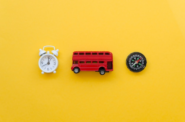 Top view bus toy with clock and compass beside Free Photo