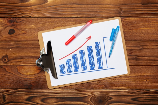 Top view of business paper chart or graph on wooden table Premium Photo